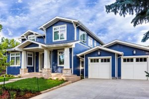 blue house with nice driveway exterior paint - spokane painting service